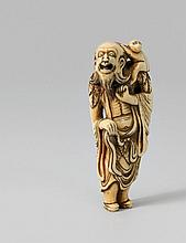 An ivory netsuke of a laughing sennin with a monkey. 18th century