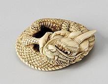 A fine Kyoto school ivory netsuke of a one-horned dragon. Late 18th/early 19th century