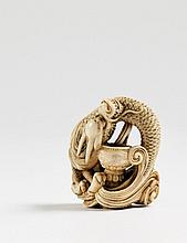 A superb ivory netsuke of a two-horned dragon. Late 18th century