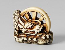 An ivory netsuke of a dragon. 18th century