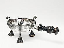 A silver rechaud, monogrammed
