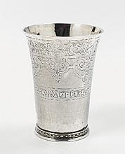 A silver beaker, monogrammed