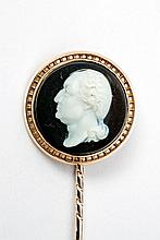 A tie pin with a Neoclassical layered onyx cameo.