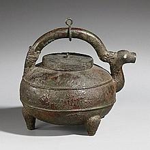 A bronze ewer (hou) on three feet. Late Han dynasty