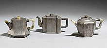 A group of three paktong teapots. 19th century