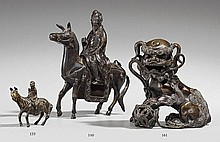 A small bronze figure of a scholar on a mule. Ming dynasty
