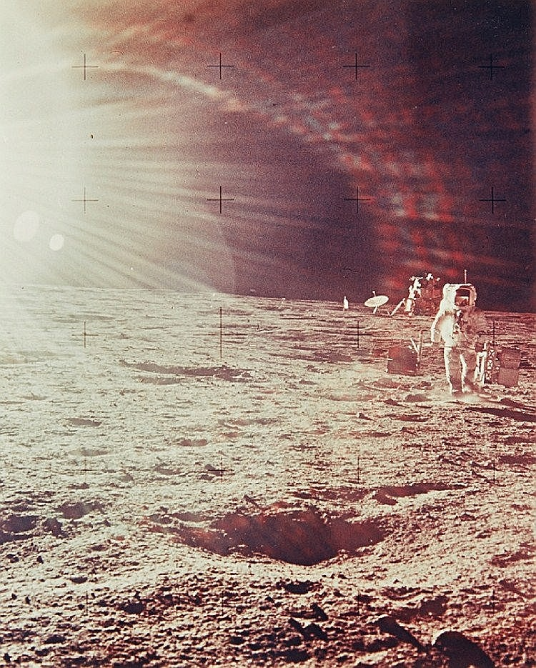 NASA, Astronaut with lunar module in background and sunglare, Apollo 12, 1969