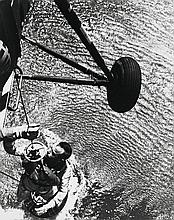 NASA, Astronaut Alan B. Shepard Jr., as he was recovered by a U.S. Marine Helicopter recovery team, Mission Mercury-Redstone 3, 1961