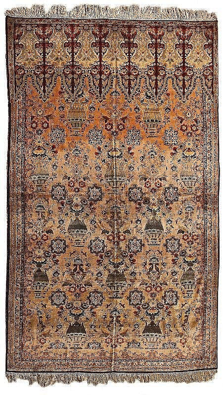 A silk Tabriz carpet with vases and rare lambrequin decoration