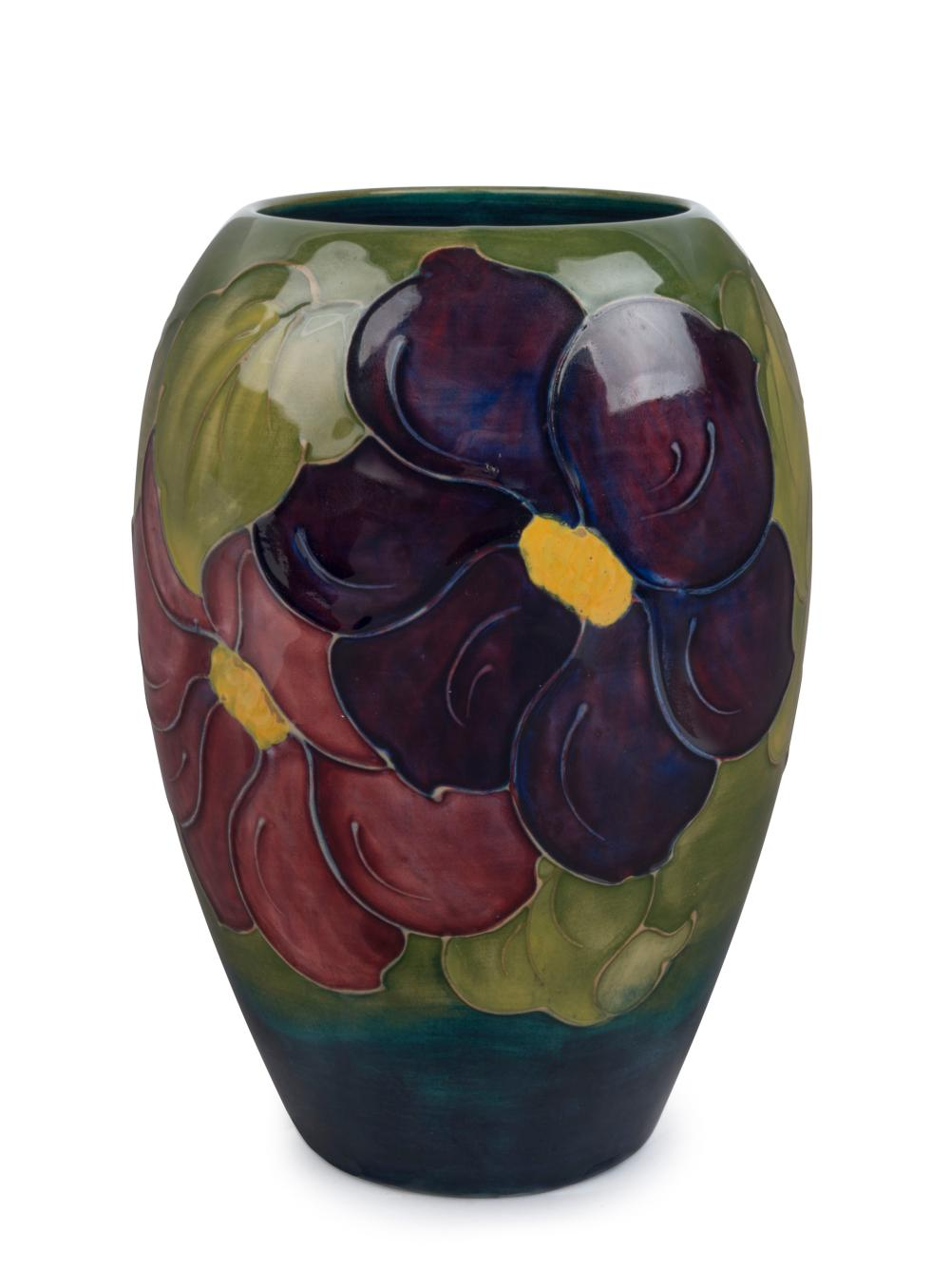 """MOORCROFT """"Clematis"""" English pottery vase on green blue ground, circa 1920s, stamped """"Moorcroft, Made in England"""", with hand signed """"W. M"""" monogram, 17.5cm high"""