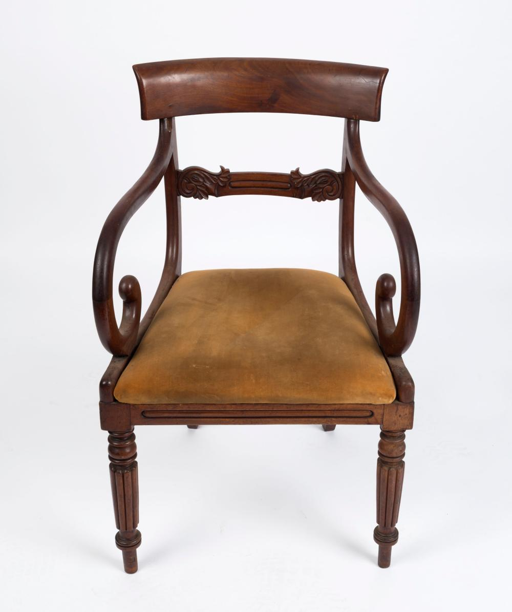 An antique English mahogany carver chair, circa 1825, 54cm across the arms