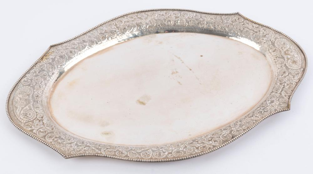 A Chinese silver serving tray with embossed floral and scroll work border and bead work rim, early 20th century, 45cm wide, 664 grams