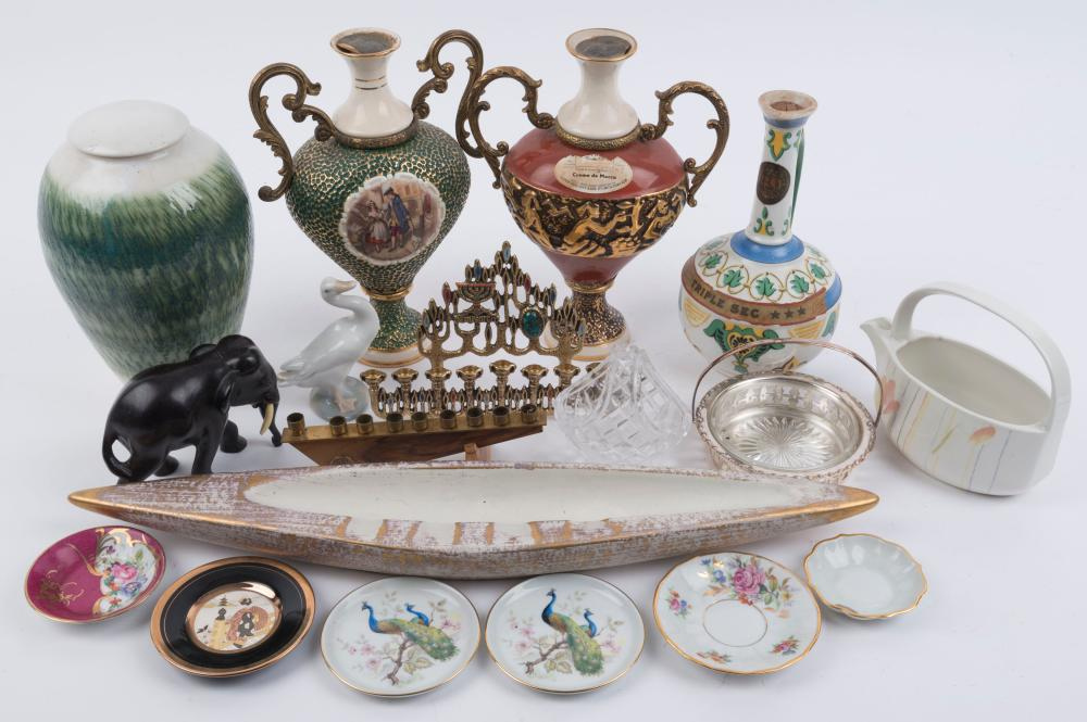 Porcelain dishes, Lladro goose statue, ceramic decanters, two Menorahs, pottery lidded vase, elephant ornament, silver plated basket and crystal basket, English porcelain jug and American ceramic ash tray, 20th century, (18 items), the ash tray 54cm
