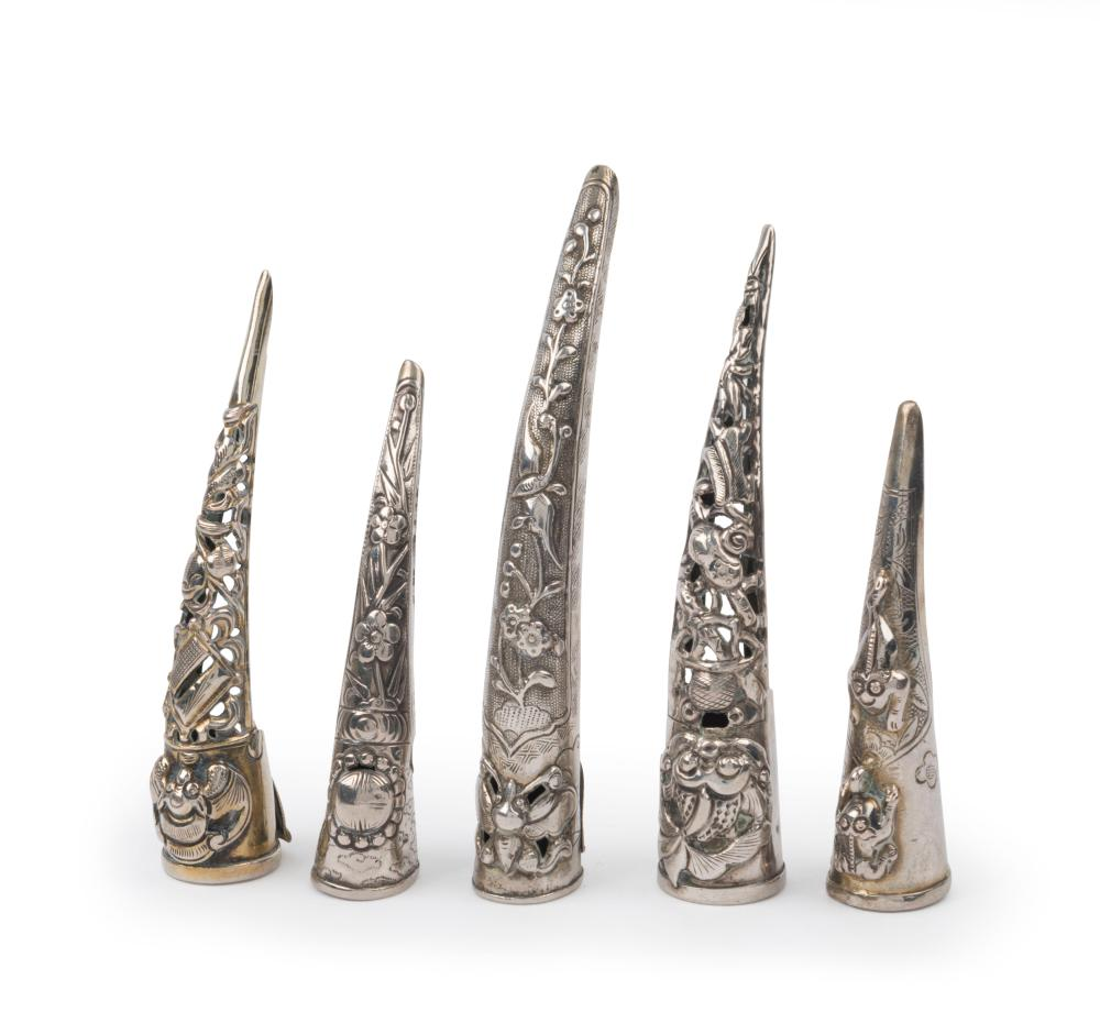 Five antique Chinese silver fingernail guards, Qing Dynasty, 19th century, the largest 8.5cm long, 38 grams total