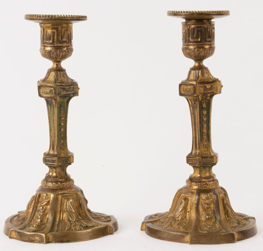 A pair of antique French ormolu candlesticks, 19th century, 20cm high