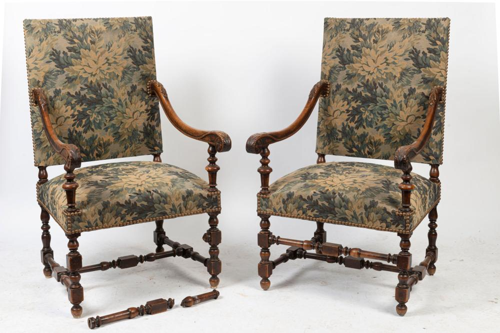 A pair of antique French carved walnut armchairs upholstered with blue floral tapestry, 19th century, 66cm across the arms