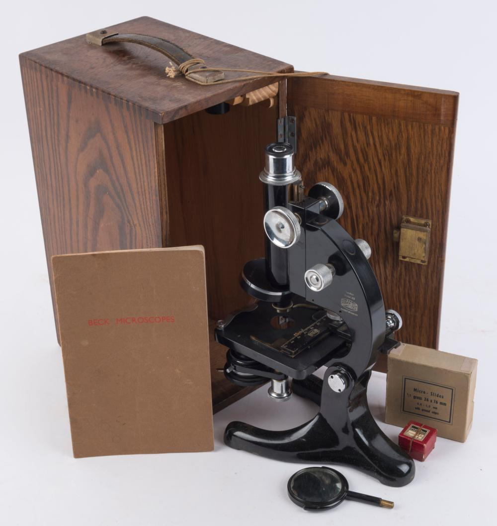 BECK MICROSCOPE Model No.29, in original case with instruction booklet and slides, early 20th century, 31cm high