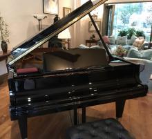 BLACK LACQUERED BOSENDORFER CONCERT GRAND PIANO