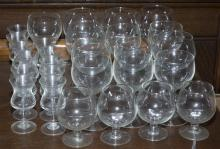 Collection of 27 glasses including 10 liquor glasses, 4 brandy glasses, and 13 wine glasses