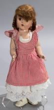 Vintage doll wearing original clothes