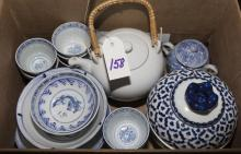 Collection of assorted Asian porcelain articles including plates, rice bowls, tea saucers, sake cups, two tea pots, and a covered jar