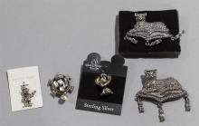 Five pieces costume jewelry including a sterling silver clown charm, a sterling silver abalone turtle pin, two marcasite cat brooche...