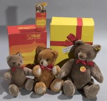 Collection of four Steiff bears; three with original boxes, various sizes.