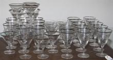 Collection of 31 etched glasses with silver rims -12 wine glasses, 11 water glasses, and 8 champagne glasses