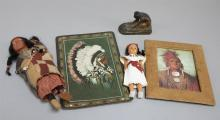 Native American related collectibles consisting of a Skokum doll with papoose, a celuloid doll in Indian dress,  a small plaste skup...
