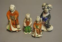 Four antique clay Japanese figures of women
