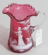 Blown cranberry glass 'Mary Gregory' jug, painted woman in white enamel, h: 6 1/2 inches.