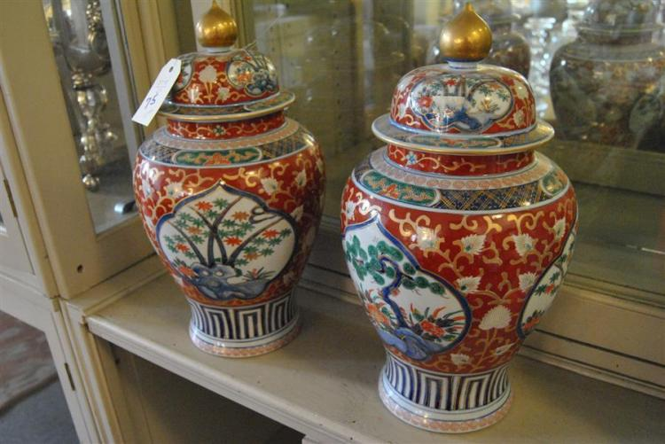 Pair of colorful Asian lidded vases
