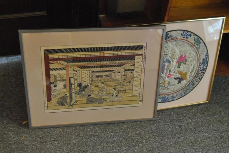 Two framed pieces of Japanese artwork including embroidered fabric and a woodblock print