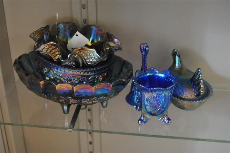 Collection of six carnival style pieces of glass including three bowls, a covered hen dish, and more