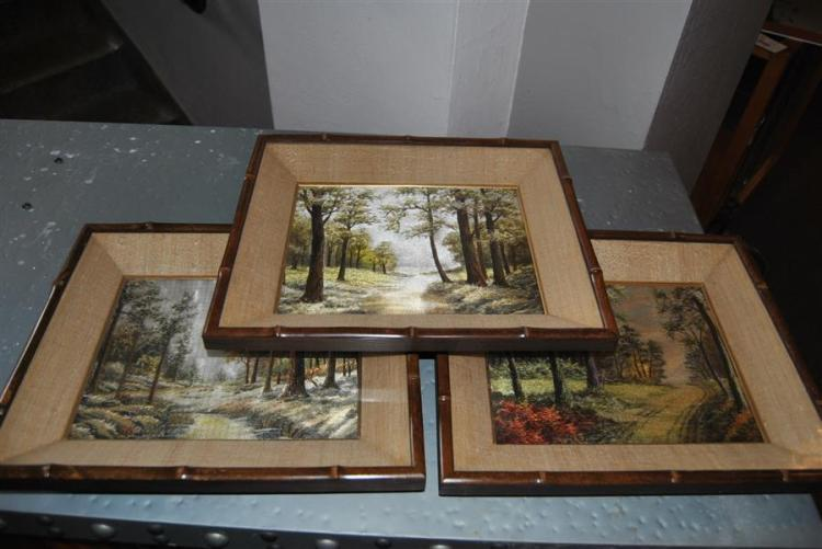 Three Japanese silk embroidered landscape scenes, in shadow frames
