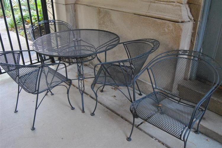 Five piece wrought iron patio set, table and four club chairs