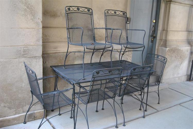 Seven piece wrought iron patio set, rectangular table and six chairs