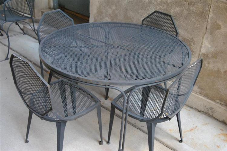 Five piece wrought iron patio set with circular table and Art Deco design chairs