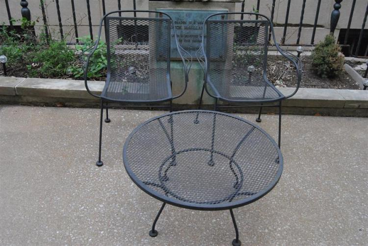 Pair of wrought iron chairs and a circular low side table