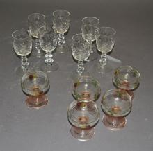 Collection of twelve glasses, seven etched wine glasses and five hand painted glasses