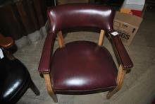 Armchair with tack upholstered red vinyl upholstery