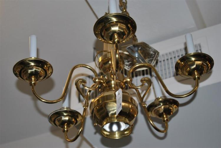 Polished brass hanging light fixture with clear glass chimneys