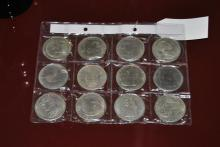 Twelve commemorative coins featuring American presidents including Lincoln, Roosevelt, Grant, Reagan, and others