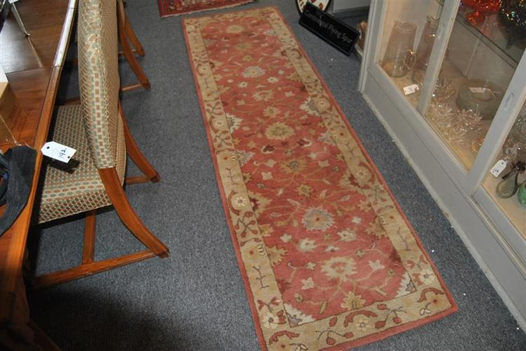 Indian wool runner with floral design on a salmon field