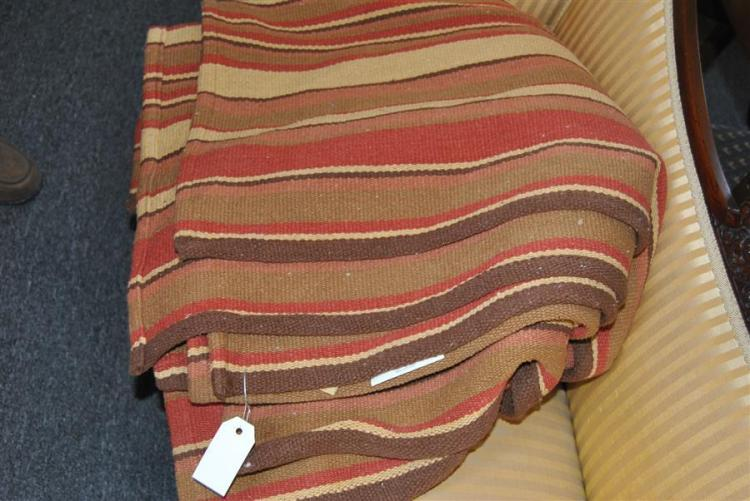 Handwoven flatweave rug decorated in bands of red, ivory and brown
