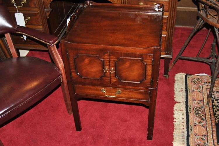 Mahogany style side table with pie crust top, featuring a cupboard door over one drawer