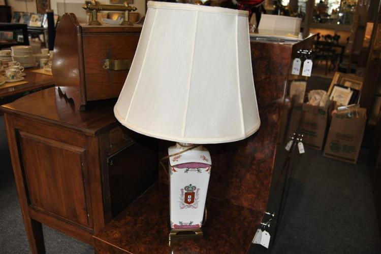 Pair of white porcelain table lamps with coat of arms motif