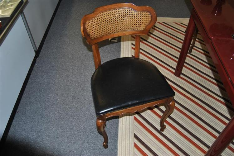 Set of four French design chairs with original cane backs and black leather upholstery