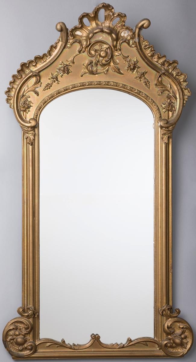 Large elaborate American gilt parcel mirror with original back