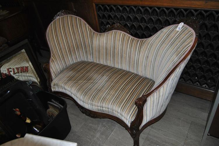 Victorian upholstered finely carved walnut settee circa 1870